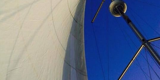 A view of the sky looking up the headsail