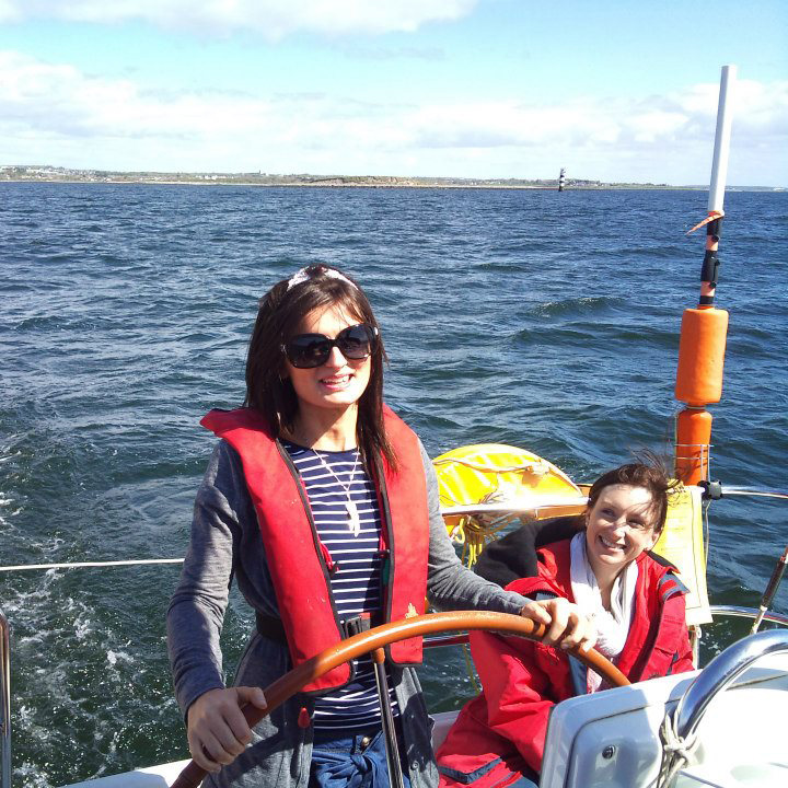 Customer at the helm of a Charter Ireland yacht