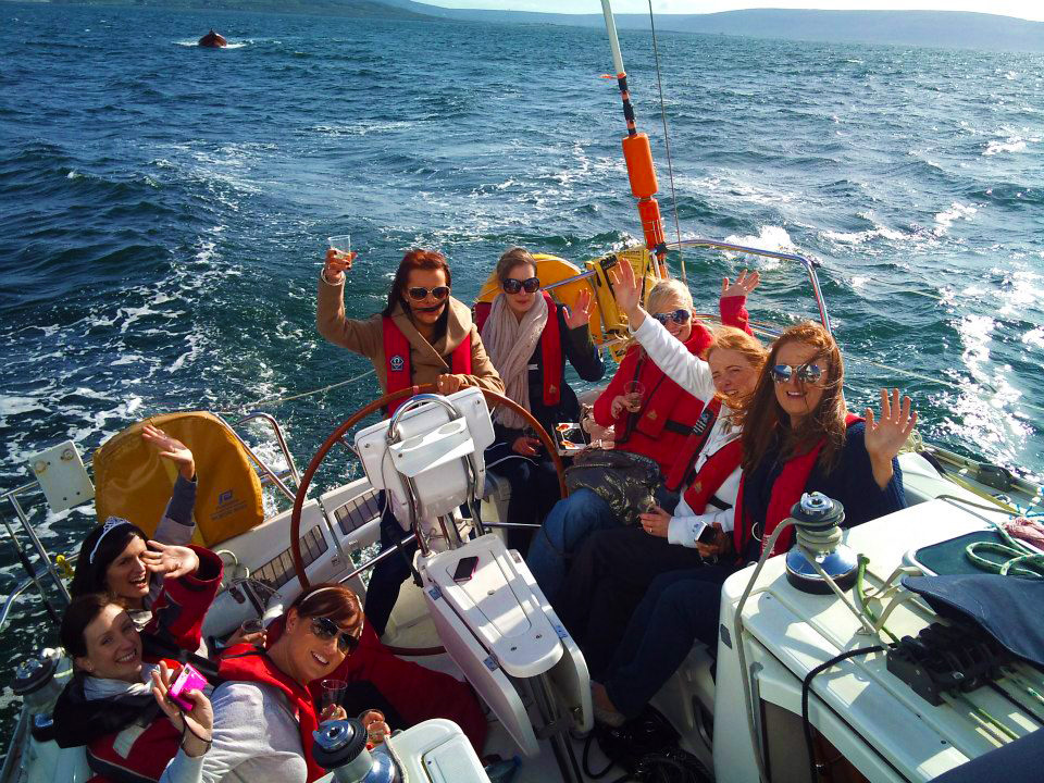 Happy group of day sailing adventurers aboard a Charter Ireland yacht