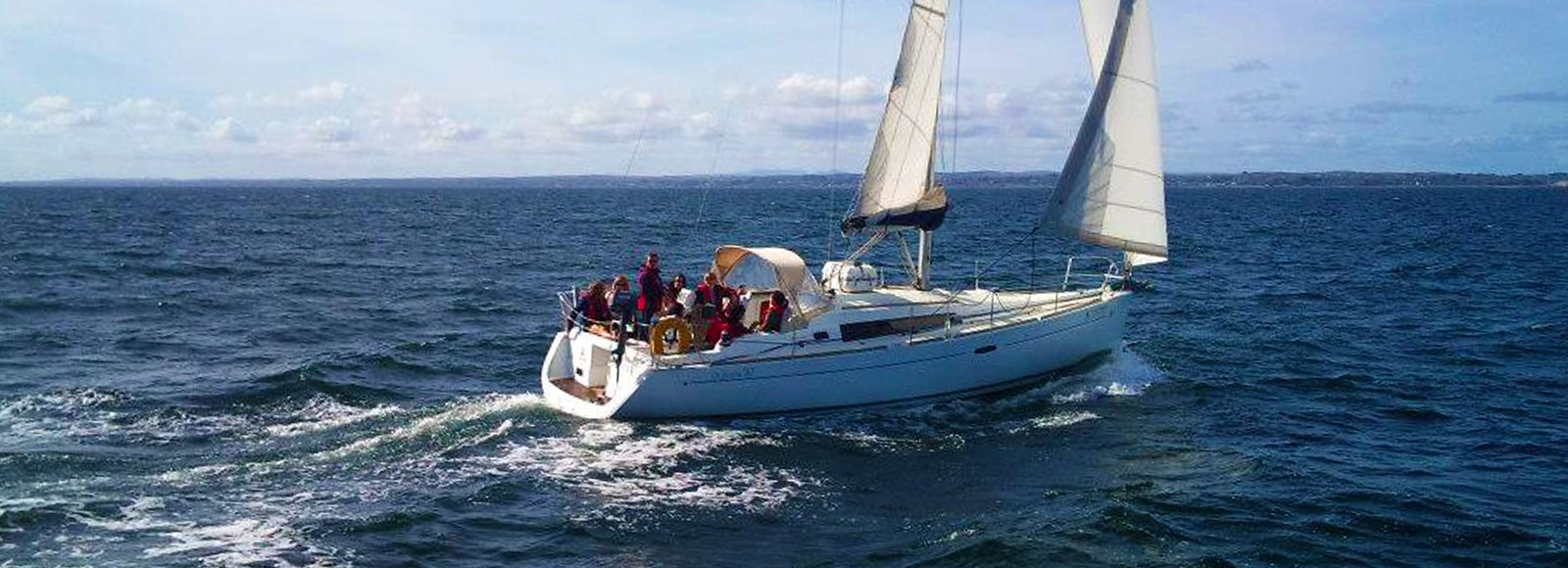 The charter yacht Súil Eile under sail in Galway Bay
